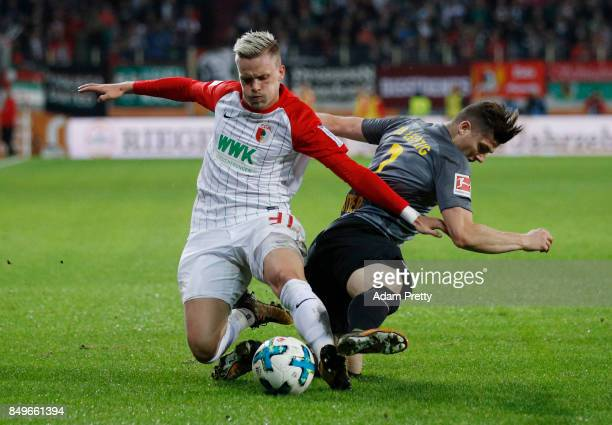 Philipp Max of Augsburg fights for the ball with Marcel Sabitzer of Leipzig during the Bundesliga match between FC Augsburg and RB Leipzig at...