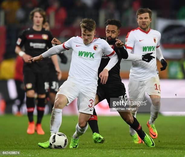Philipp Max of Augsburg is challenged by Karim Bellarabi of Leverkusen during the Bundesliga match between FC Augsburg and Bayer 04 Leverkusen at WWK...