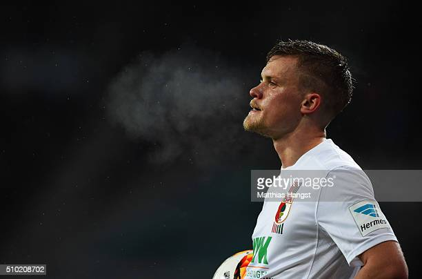 Philipp Max of Augsburg looks thoughtful during the Bundesliga match between FC Augsburg and FC Bayern Muenchen at SGL Arena on February 14 2016 in...
