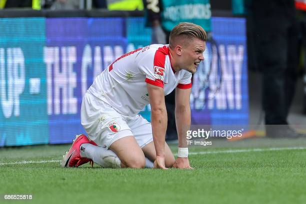 Philipp Max of Augsburg on the ground during the Bundesliga match between FC Augsburg and Borussia Dortmund at the WWKArena on May 13 2017 in...