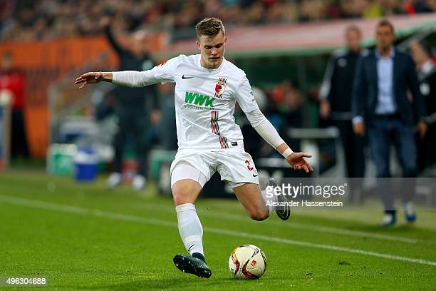 Philipp Max of Augsburg runs with the ball with of Bremen during the Bundesliga match between FC Augsburg and SV Werder Bremen at WWK Arena on...