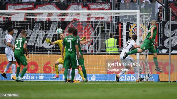 Philipp Max of Augsburg scores his team's first goal during the Bundesliga match between Eintracht Frankfurt and FC Augsburg at CommerzbankArena on...