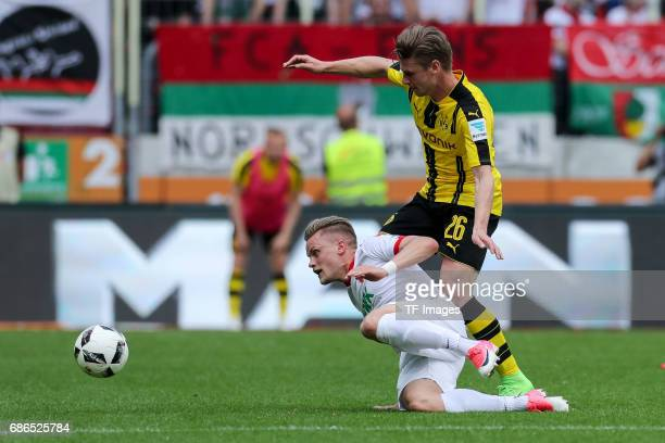 Philipp Max of Augsburg und Lukasz Piszczek of Dortmund battle for the ball during the Bundesliga match between FC Augsburg and Borussia Dortmund at...