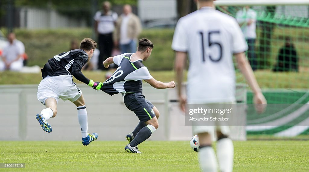 Philipp Menzel of Germany pulls the jersey of Jamie Aherne of Ireland during the international friendly match between Germany and Ireland on May 11...