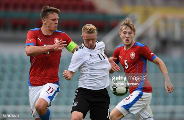 Philipp Ochs of Germany and Josef Kvida and David Stepanek of the Czech Republic vie for the ball during the Under 20 Elite League match between U20...