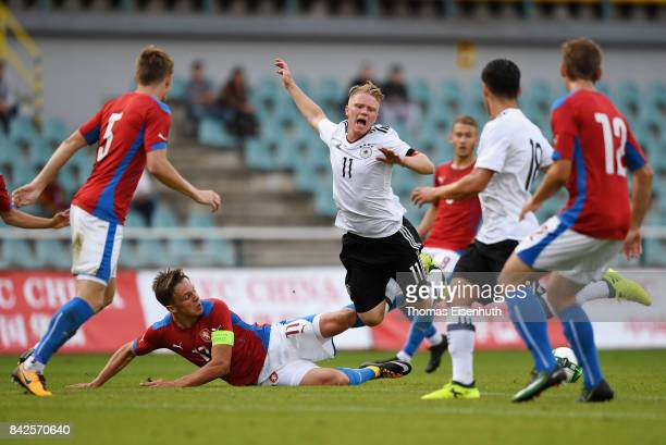 Philipp Ochs of Germany and Josef Kvida of the Czech Republic vie for the ball during the Under 20 Elite League match between U20 of the Czech...