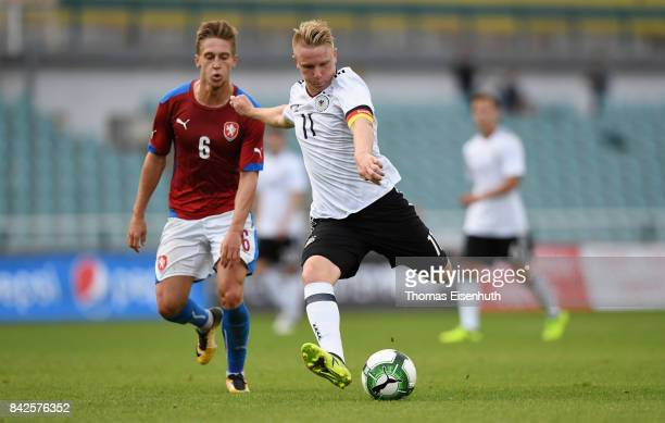 Philipp Ochs of Germany and Tomas Wiesner of the Czech Republic vie for the ball during the Under 20 Elite League match between U20 of the Czech...