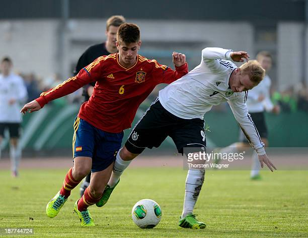 Philipp Ochs of Germany battles for the ball with Ramiro Caricol of Spain during the U17 international friendly match between Germany and Spain at...
