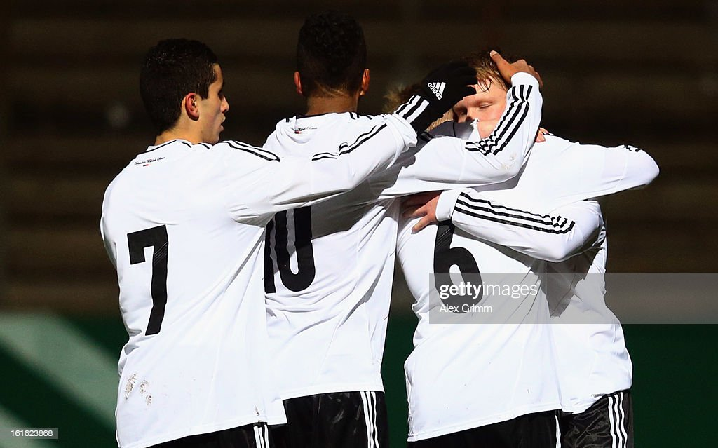 Philipp Ochs of Germany celebrates his team's first goal with team mates Thore-Andreas Jacobsen, Benjamin Henrichs and Taoufiq Naciri (R-L) during the U16 international friendly match between Germany and England at Suedstadion on February 13, 2013 in Cologne, Germany.