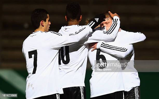 Philipp Ochs of Germany celebrates his team's first goal with team mates ThoreAndreas Jacobsen Benjamin Henrichs and Taoufiq Naciri during the U16...