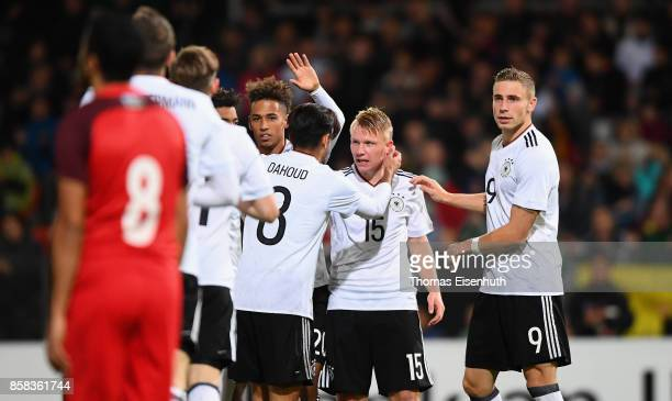 Philipp Ochs of Germany celebrates with teammates after his opening goal during the UEFA Under21 Euro 2019 Qualifier match between U21 of Germany and...