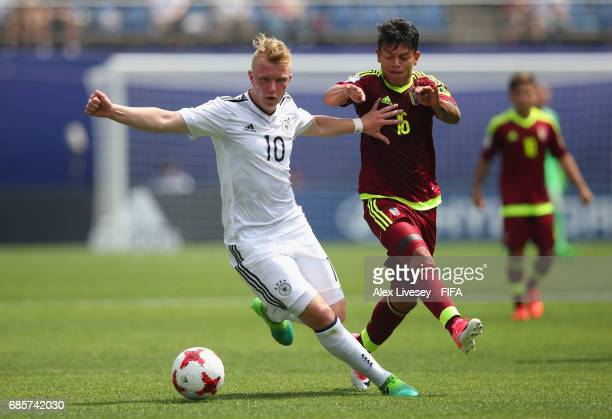 Philipp Ochs of Germany holds off a challenge from Ronaldo Lucena of Venezuela during the FIFA U20 World Cup Korea Republic 2017 group B match...