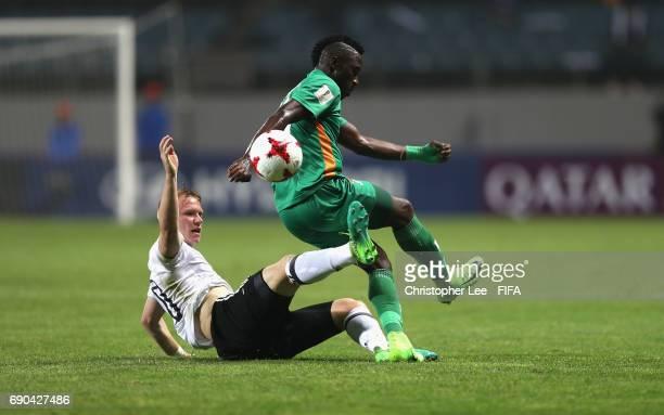 Philipp Ochs of Germany tackles Fashion Sakala of Zambia during the FIFA U20 World Cup Korea Republic 2017 Round of 16 match between Zambia and...