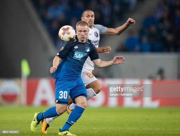 Philipp Ochs of Hoffenheim is tackled by Goekhan Inler of Istanbul during the UEFA Europa League group C match between 1899 Hoffenheim and Istanbul...