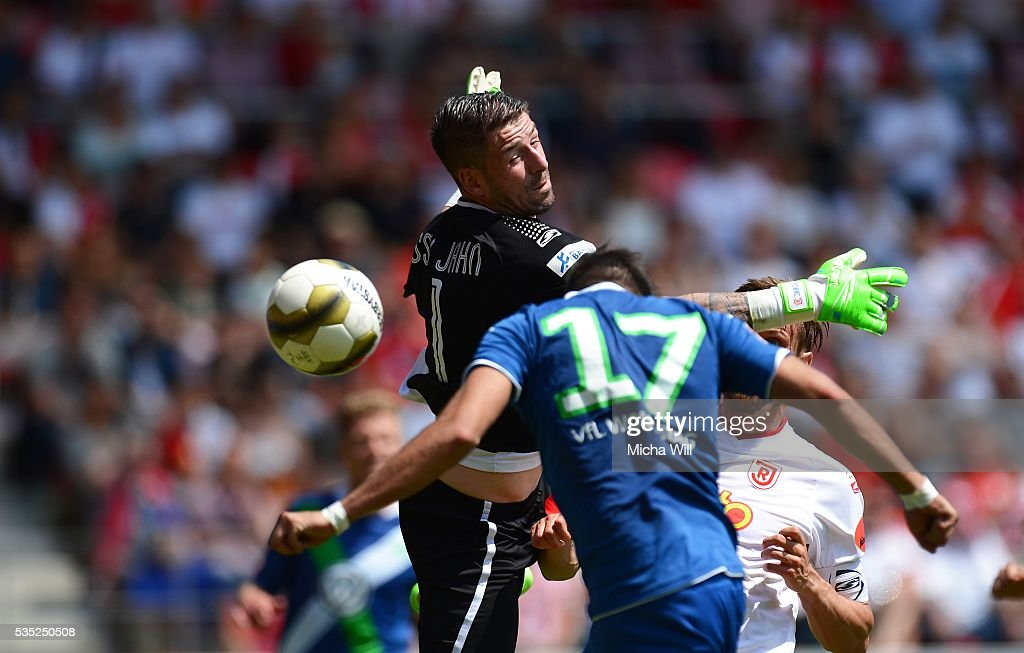 Philipp Pentke (L), goalkeeper of Regensburg parries the ball during the Third League play off second leg match between Jahn Regensburg and VfL Wolfsburg II at Continental Arena on May 29, 2016 in Regensburg, Germany.