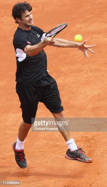 Philipp Petzschner of Germany plays a forehand during the blue group match between Philipp Petzschner of Germany and Igor Andreev of Russia during...