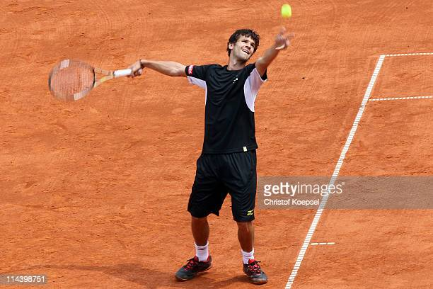 Philipp Petzschner of Germany servees during the blue group match between Philipp Petzschner of Germany and Igor Andreev of Russia during day five of...