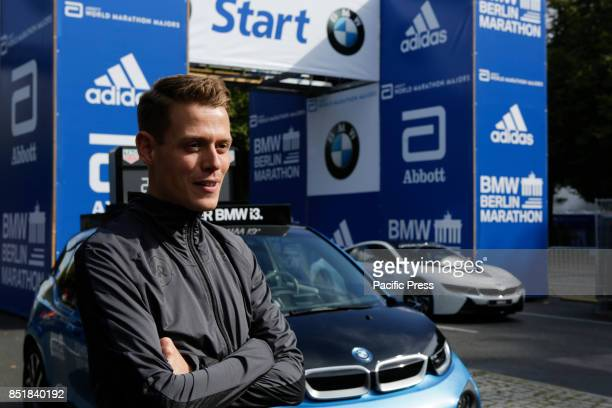 Philipp Pfleger from Germany poses for the cameras at the starting line The leading male and female runners for the 44th BMW Berlin Marathon as well...