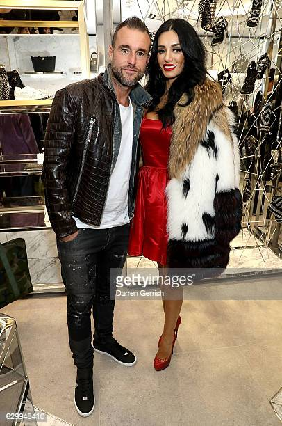 Philipp Plein and Andreea Sasu attend a cocktail party to celebrate the opening of the Philipp Plein London Boutique on December 15 2016 in London...