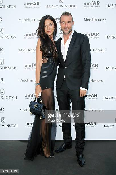 Philipp Plein and guest attend the amfAR dinner at the Pavillon LeDoyen during the Paris Fashion Week Haute Couture on July 5 2015 in Paris France