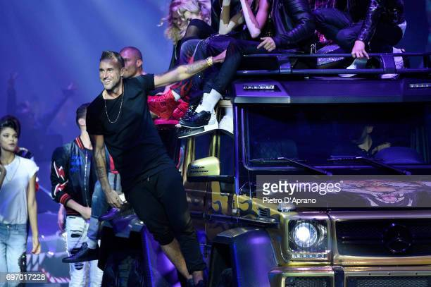 Philipp Plein and models aknowledge the applause of the audience at the Philipp Plein show during Milan Men's Fashion Week Spring/Summer 2018 on June...
