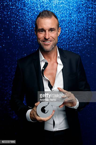 Philipp Plein poses backstage at the GQ Men of the year Award 2016 at Komische Oper on November 10 2016 in Berlin Germany