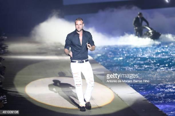 Philipp Plein walks the runway during the Philipp Plein show as a part of Milan Fashion Week Menswear Spring/Summer 2015 on June 21 2014 in Milan...