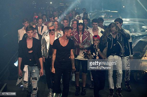 Philipp Plein walks the runway with a group of models after his show as part of Milan Men's Fashion Week Spring/Summer 2016 on June 20 2015 in Milan...