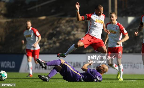 Philipp Riese of Aue challenges Jann George of Regensburg during the Second Bundesliga match between FC Erzgebirge Aue and SSV Jahn Regensburg at...