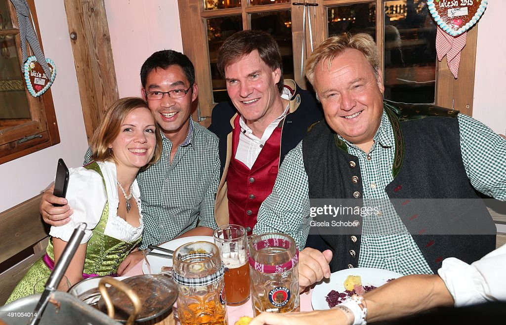 Philipp Roesler and his wife Wiebke Roesler; <a gi-track='captionPersonalityLinkClicked' href=/galleries/search?phrase=Carsten+Maschmeyer&family=editorial&specificpeople=5704007 ng-click='$event.stopPropagation()'>Carsten Maschmeyer</a> and Dr. Christoph Walther during the Oktoberfest 2015 at Kaeferschaenke at Theresienwiese on Oktober 02, 2015 in Munich, Germany.