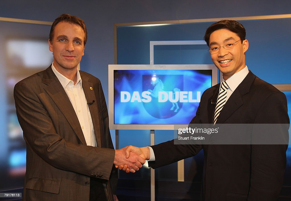 Philipp Roesler (L), candidate of the Free Democrats (FDP) and Stefan Wenzel (R), candidate of the Greens Party attend a television debate the NDR television studios on January 23, 2008 in Hanover, Germany. Lower Saxony faces state elections on January 27, 2008.