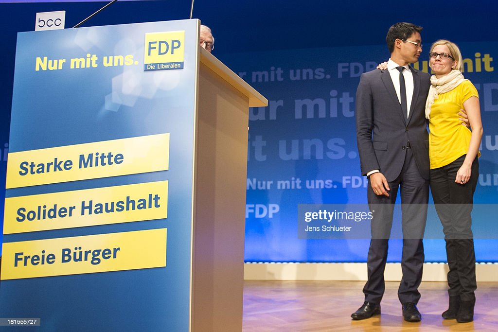 Philipp Roesler (L), Chairman of the German Free Democrats (FDP) and his wife Wiebke Roesler (R) leave the stage after the speech to the supporters of the German Free Democrats (FDP) at FDP party headquarters after the German federal elections on September 22, 2013 in Berlin, Germany. Germany is holding federal elections that will determine whether current Chancellor Angela Merkel of the German Christian Democrats (CDU) will remain for a third term. Though the CDU has a strong lead over the opposition, speculations run wide as to what coalition will be viable in coming weeks to create a new government.