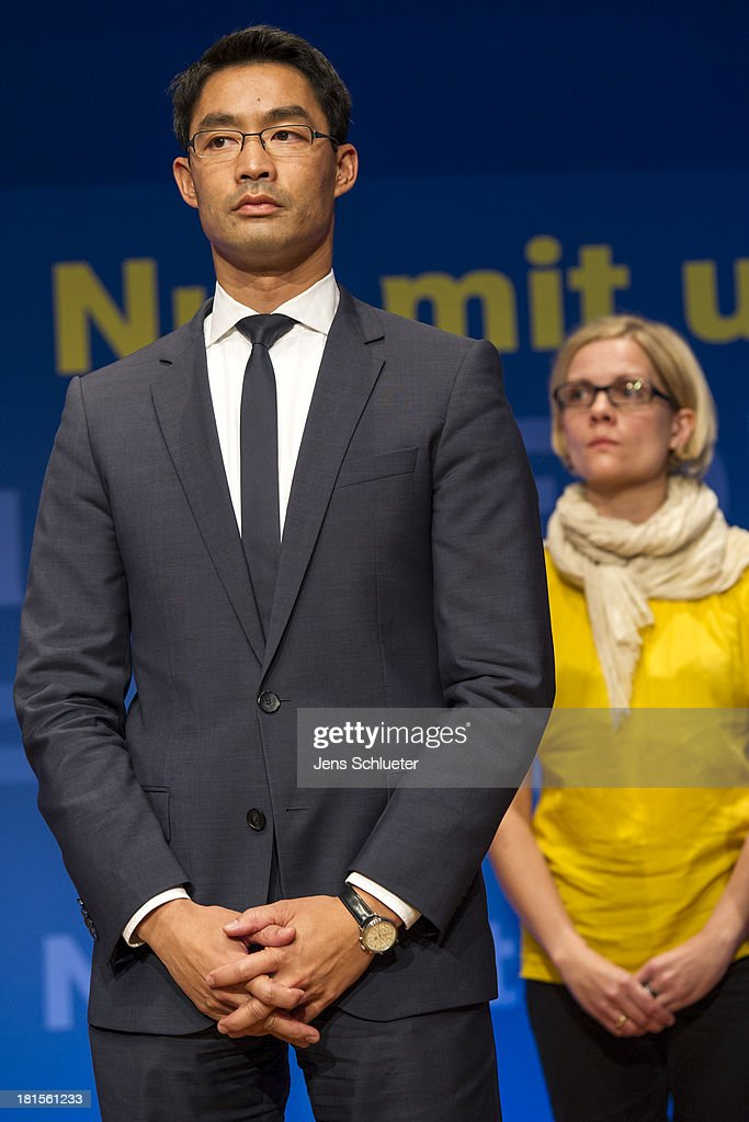 Philipp Roesler, Chairman of the German Free Democrats (FDP) and his wife Wiebke Roesler stand on the stage during the speech to the supporters of the German Free Democrats (FDP) at FDP party headquarters after the German federal elections on September 22, 2013 in Berlin, Germany. Germany is holding federal elections that will determine whether current Chancellor Angela Merkel of the German Christian Democrats (CDU) will remain for a third term. Though the CDU has a strong lead over the opposition, speculations run wide as to what coalition will be viable in coming weeks to create a new government.