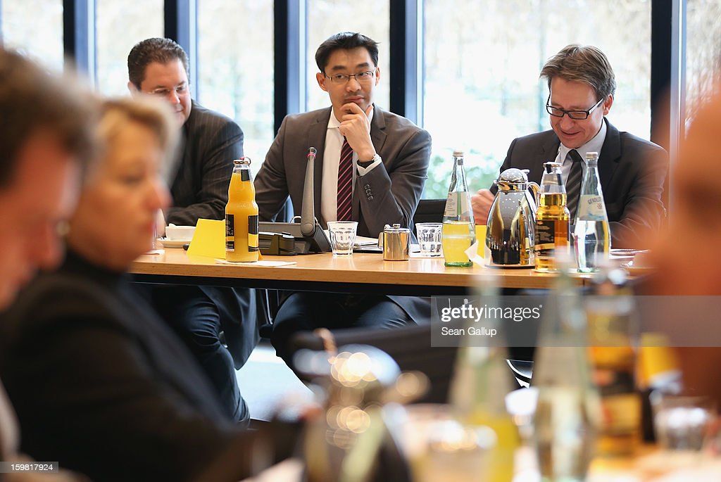 Philipp Roesler (C), Chariman of the German Free Democrats (FDP), presides over a meeting of the FDP governing board with FDP lead candidate in Lower Saxony elections Stefan Birkner (R) the day after the party achieved ist best result ever in elections in Lower Saxony on January 21, 2013 in Berlin, Germany. According to breaking news reports Roesler will remain as party chairman though FDP Bundestag faction leader Rainer Bruederle will become the party's candidate for chancellor in German national elections scheduled for later this year. Many FDP supporters blame Roesler for a steady decline in the party's nationwide popularity.