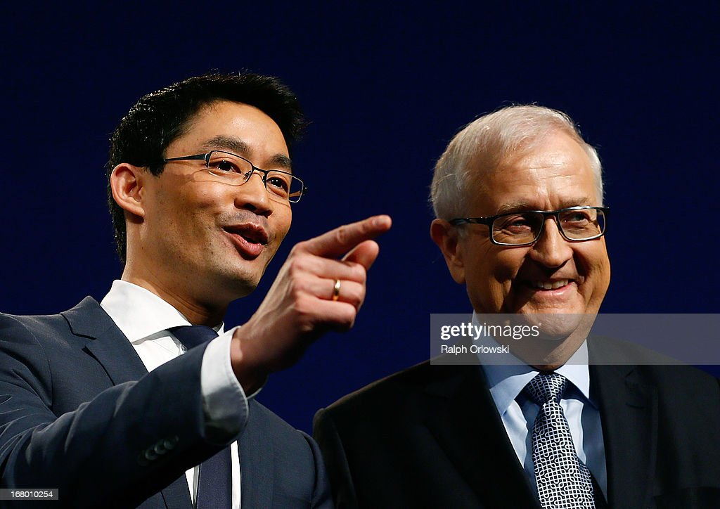 Philipp Roesler (L), head of the German Free Democrats (FDP) political party and top candidate Rainer Bruederle react at the FDP federal congress (Bundesparteitag) on May 4, 2013 in Nuremburg, Germany. The FDP is the junior partner in the current German government coalition, though its popularity has faltered in recent years and the party is in danger of not receiving the required minimum of 5% of votes to retain seats in the Bundestag in federal elections scheduled for September.