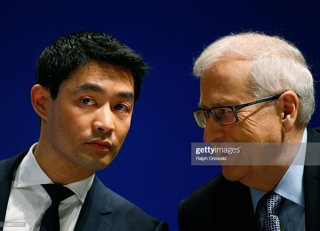 Philipp Roesler (L), head of the German Free Democrats (FDP) political party and top candidate Rainer Bruederle chat at the FDP federal congress (Bundesparteitag) on May 4, 2013 in Nuremburg, Germany. The FDP is the junior partner in the current German government coalition, though its popularity has faltered in recent years and the party is in danger of not receiving the required minimum of 5% of votes to retain seats in the Bundestag in federal elections scheduled for September.