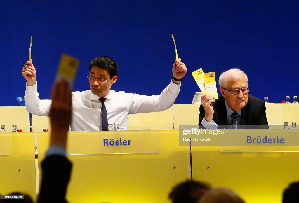 Philipp Roesler (L), head of the German Free Democrats (FDP) political party and top candidate Rainer Bruederle cast their votes at the FDP federal congress (Bundesparteitag) on May 4, 2013 in Nuremburg, Germany. The FDP is the junior partner in the current German government coalition, though its popularity has faltered in recent years and the party is in danger of not receiving the required minimum of 5% of votes to retain seats in the Bundestag in federal elections scheduled for September.