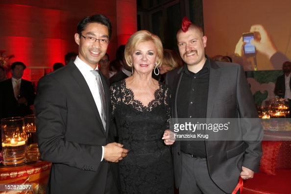 Philipp Roesler Liz Mohn and Sascha Lobo attend the Bertelsmann Summer Reception on September 27 2012 in Berlin Germany