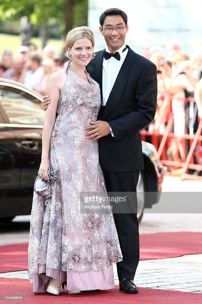 Philipp Roesler, Vice Chancellor and Chairman of the German Free Democrats (FDP) and his wife Wiebke attend Bayreuth Festival Opening 2013 on July 25, 2013 in Bayreuth, Germany.