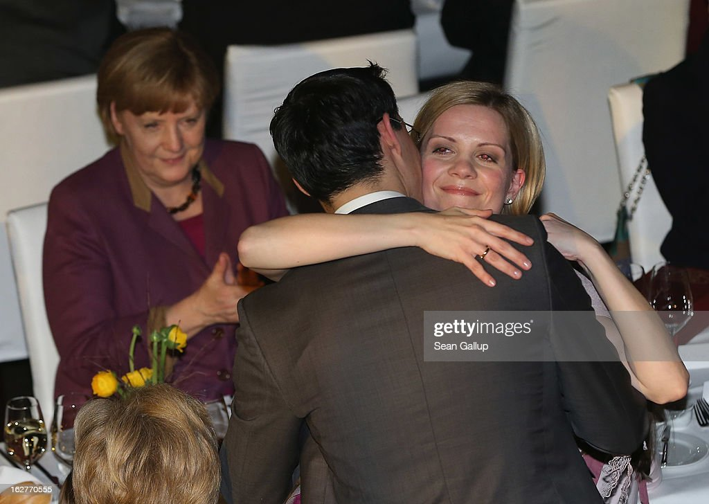 <a gi-track='captionPersonalityLinkClicked' href=/galleries/search?phrase=Philipp+Roesler&family=editorial&specificpeople=4838791 ng-click='$event.stopPropagation()'>Philipp Roesler</a>, Vice Chancellor and Chairman of the German Free Democrats (FDP), embraces his wife Wiebke as German Chancellor and Chairwoman of the German Christian Democrats (CDU) <a gi-track='captionPersonalityLinkClicked' href=/galleries/search?phrase=Angela+Merkel&family=editorial&specificpeople=202161 ng-click='$event.stopPropagation()'>Angela Merkel</a> look on after he spoke at his 40th birthday celebration on February 26, 2013 in Berlin, Germany. The FDP and CDU are the current German government coalition, though the FDP has faced a very challenging last 18 months that has brought the party to its lowest popularity ratings in decades. Germany faces federal elections in September.