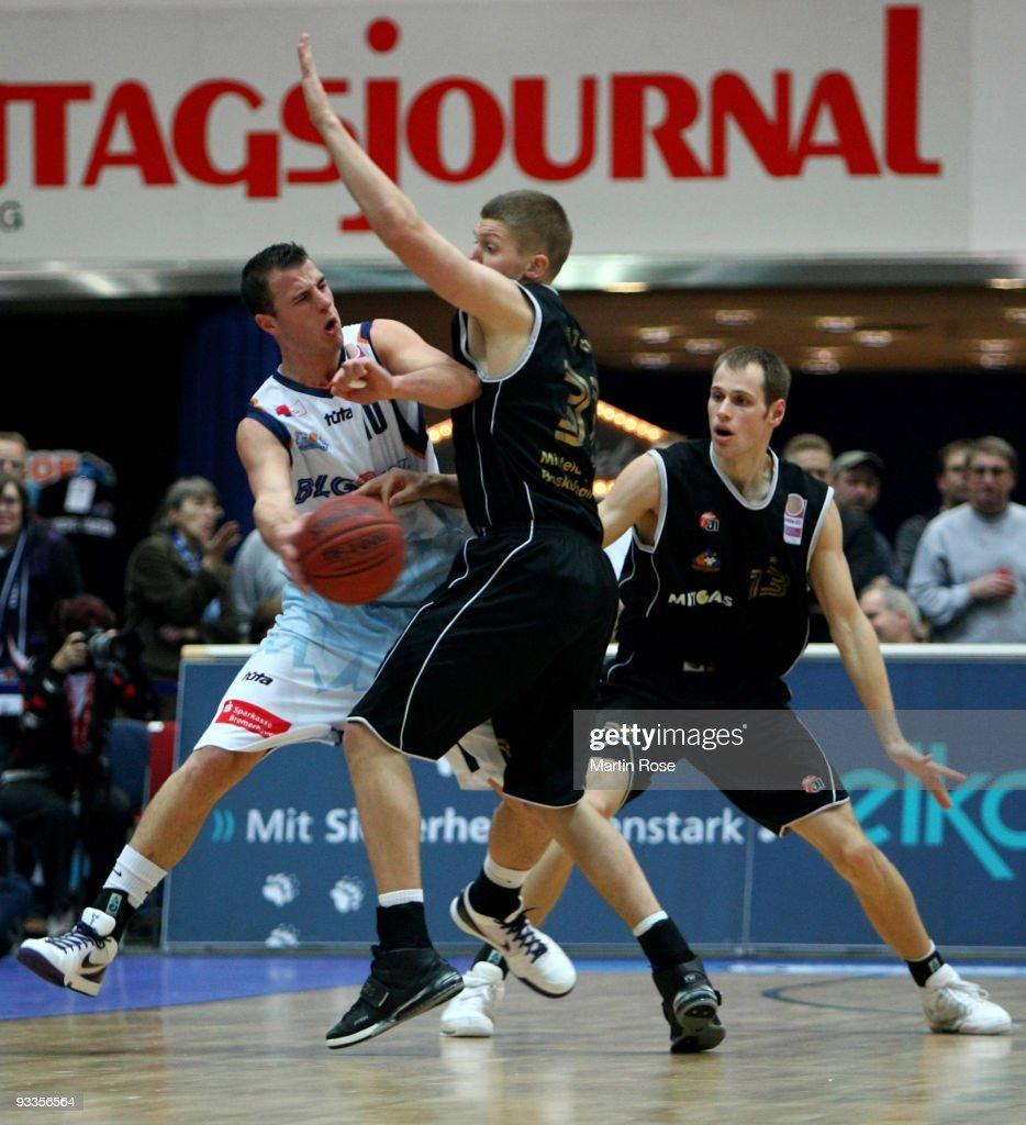 Philipp Schwethelm of Bremerhaven is attacked by Matt Stucki and Nikita Khartchenkov of Mitteldeutscher BC during the Beko Basketball Bundesliga game...