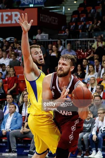 Philipp Schwethelm of Oldenburg and Danilo Barthel of Bayern Muenchen battle for the ball during the easyCredit BBL Basketball Bundesliga match...