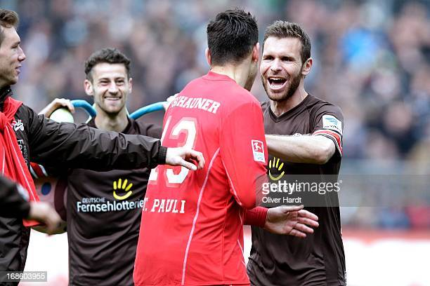 Philipp Tschauner and Markus Thorandt of Pauli celebrates after the Second Bundesliga match between FC Sankt Pauli and Eintracht Braunschweig at...