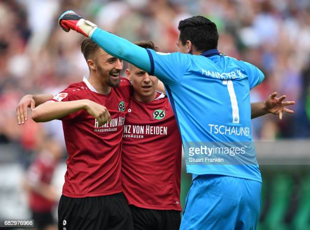 Philipp Tschauner Florian Hbner and Waldemar Anton of Hannover celebrate promotion at the end of the Second Bundesliga match between Hannover 96 and...