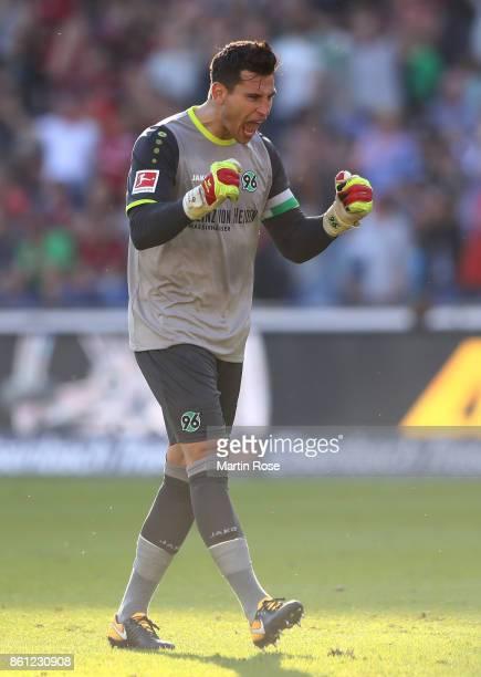 Philipp Tschauner goalkeeper of Hannover celebrates the equalizing goal during the Bundesliga match between Hannover 96 and Eintracht Frankfurt at...