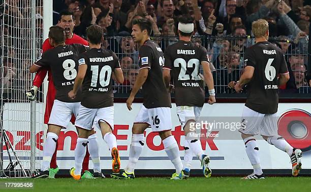 Philipp Tschauner goalkeeper of StPauli celebrates after he saves the penalty shot of Christian Fiel of Dreden during the Second Bundesliga match...