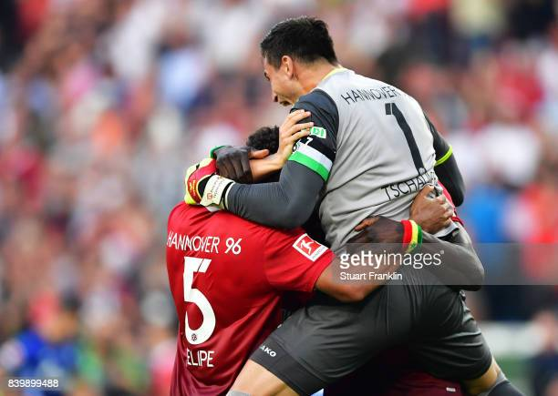 Philipp Tschauner of Hannover 96 celebrates victory with team mates after the Bundesliga match between Hannover 96 and FC Schalke 04 at HDIArena on...