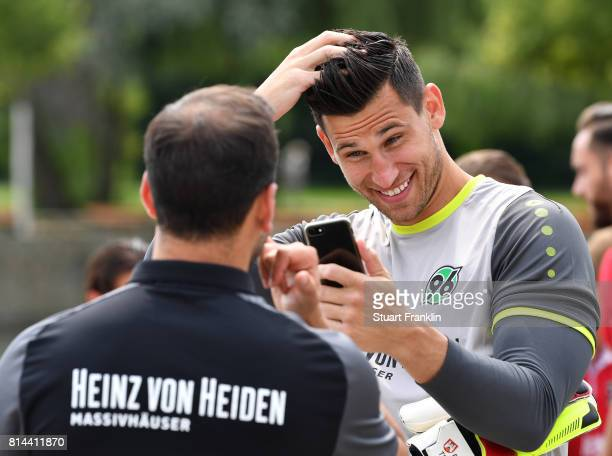 Philipp Tschauner of Hannover 96 checks his hair during the team presentation at on July 14 2017 in Hanover Germany