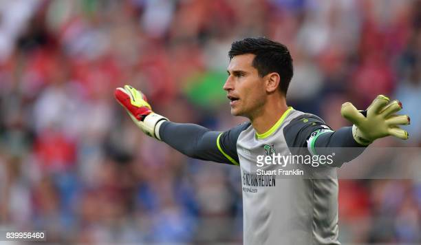 Philipp Tschauner of Hannover gestures during the Bundesliga match between Hannover 96 and FC Schalke 04 at HDIArena on August 27 2017 in Hanover...