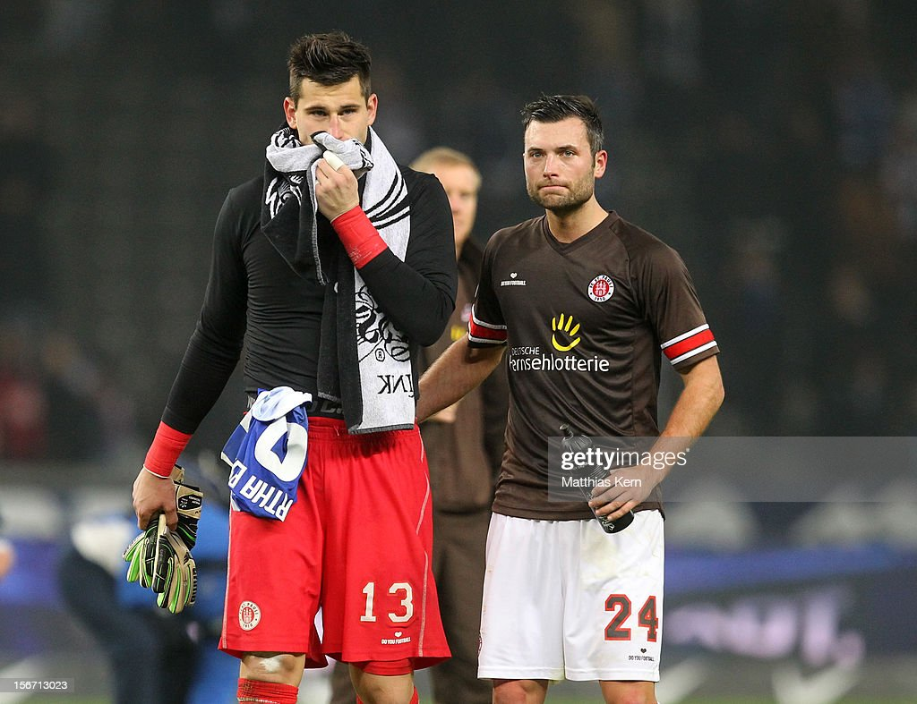 Philipp Tschauner (L) of St. Pauli and team mate Florian Mohr (R) show their frustration after loosing the Second Bundesliga match between Hertha BSC Berlin and FC St. Pauli at Olympic stadium on November 19, 2012 in Berlin, Germany.